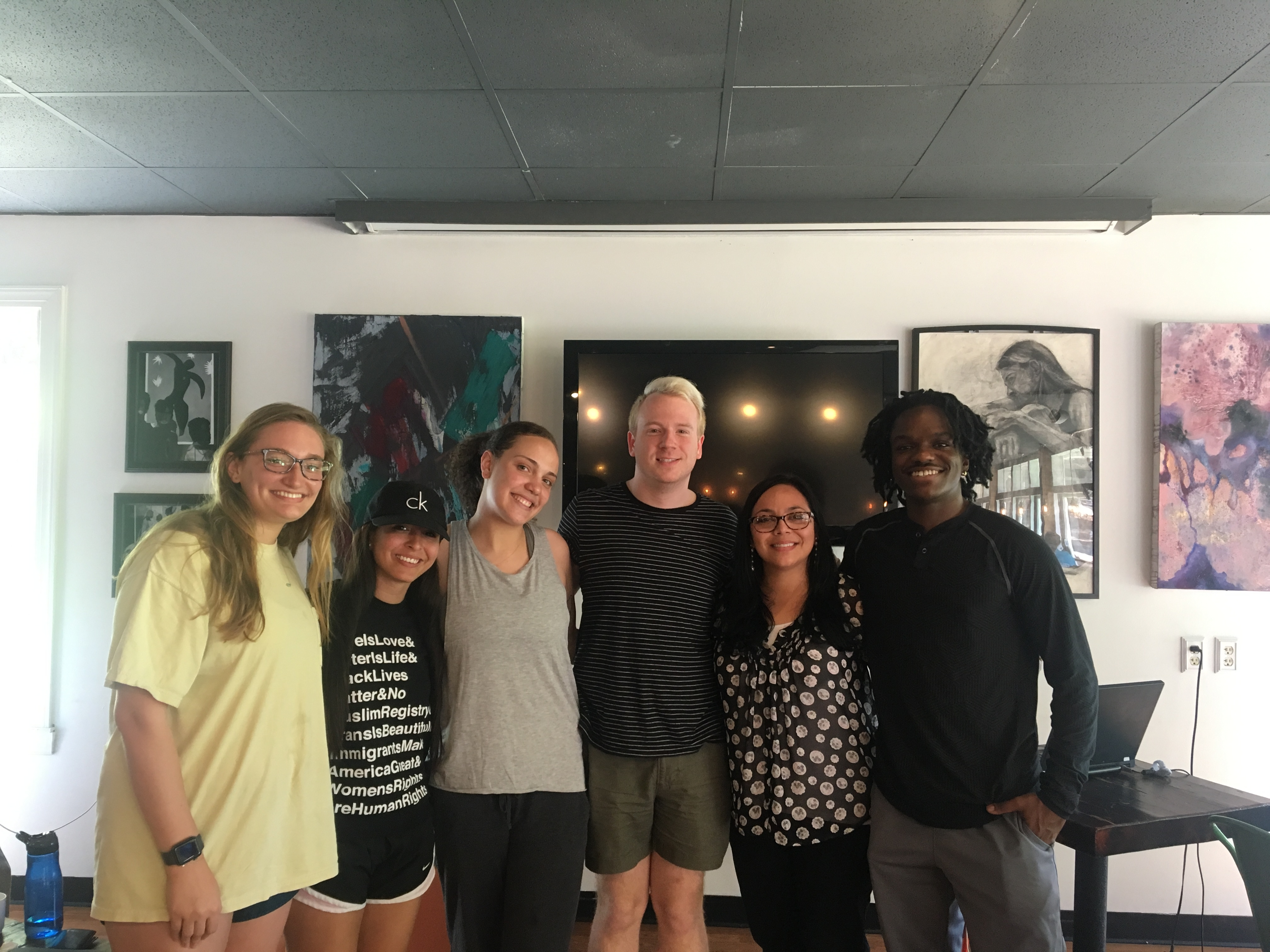 The six original members of the Davidson Microaggressions Project standing in a line in front of art work.