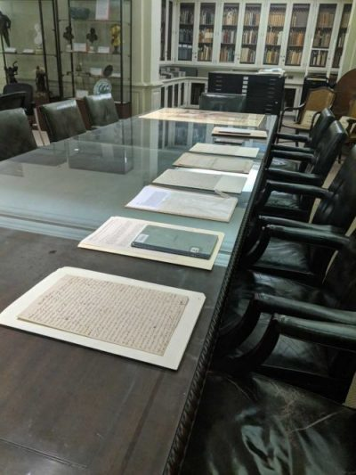 Documents lined up on a table in the rare book room.